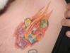 Colorful flaming dice tattoo