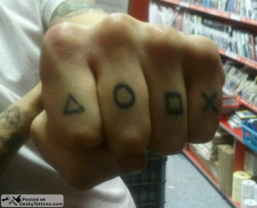 I posted some of the geekiest knuckle tattoos out there already